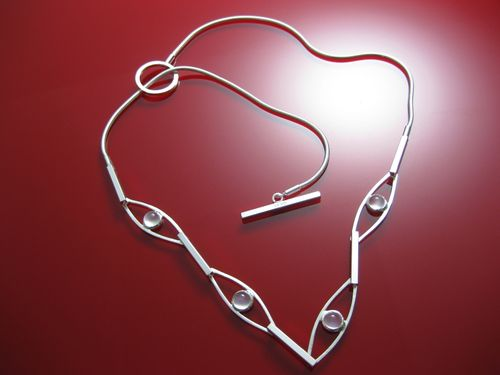Nicole D'Entremont_Moonstone Necklace on Red